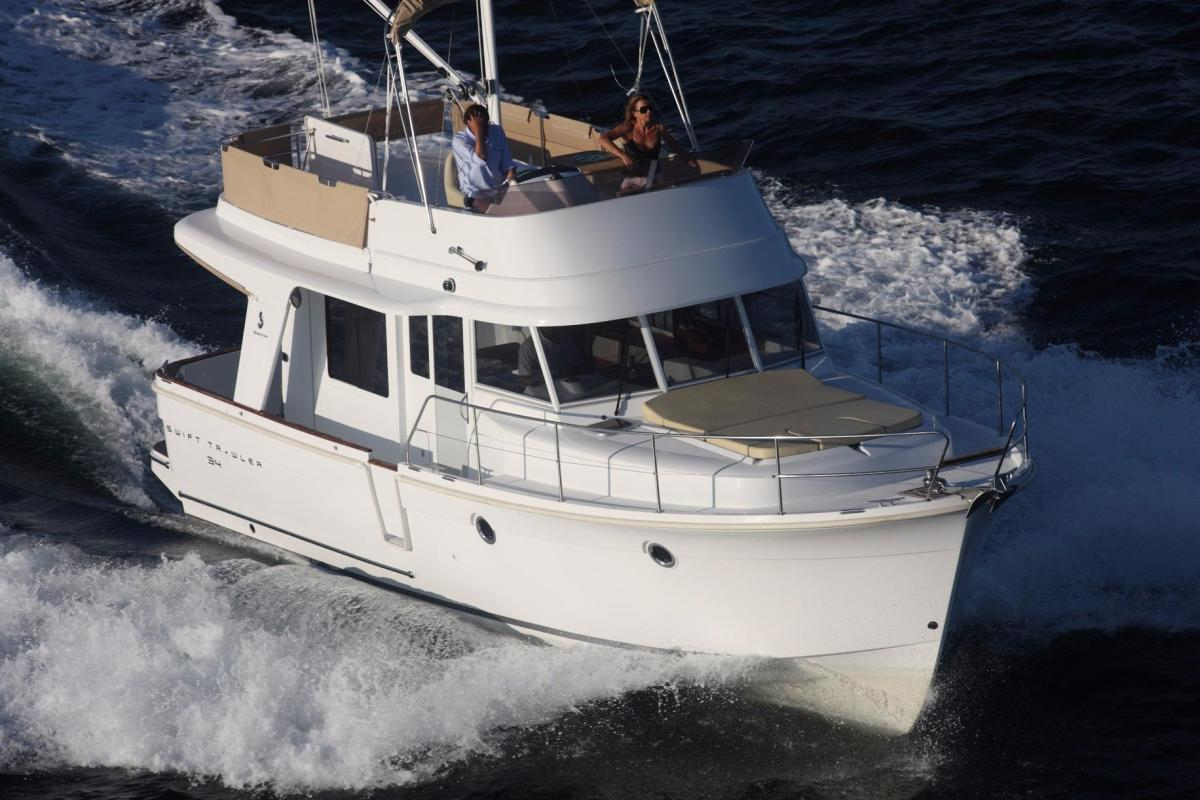The Beneteau Swift Trawler 34's semidisplacement hull gives it some of the stability and seaworthiness characteristics of a displacement hull while offering more speed.