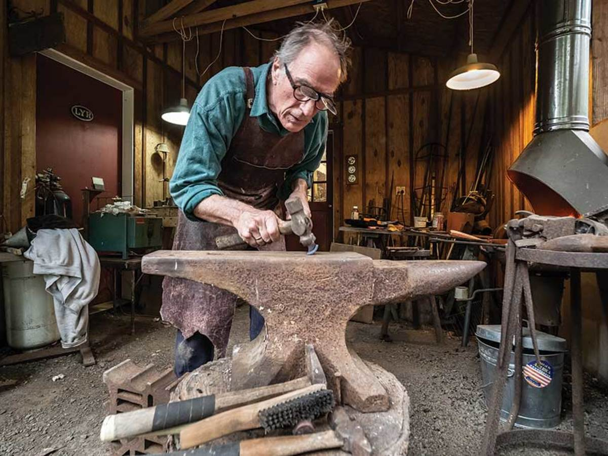 Louchard hammers out a curved gouge from the forge.