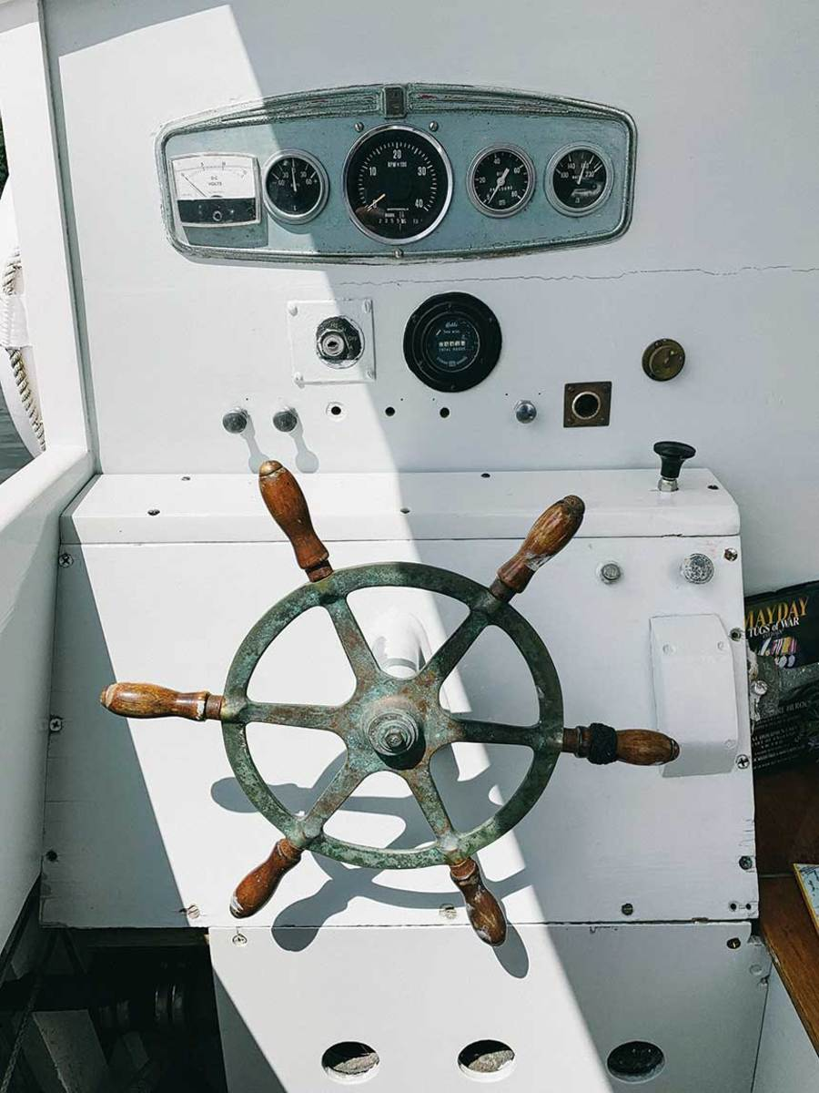 The wheel came off a catboat and the engine panel off General George S. Patton's schooner.