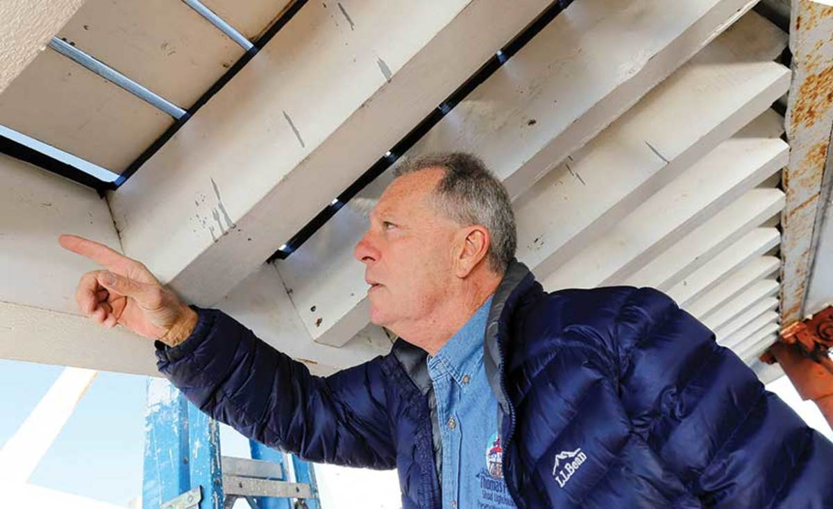 Preservation foreman John Potvin points out a new beam that was recently fitted to the lighthouse.