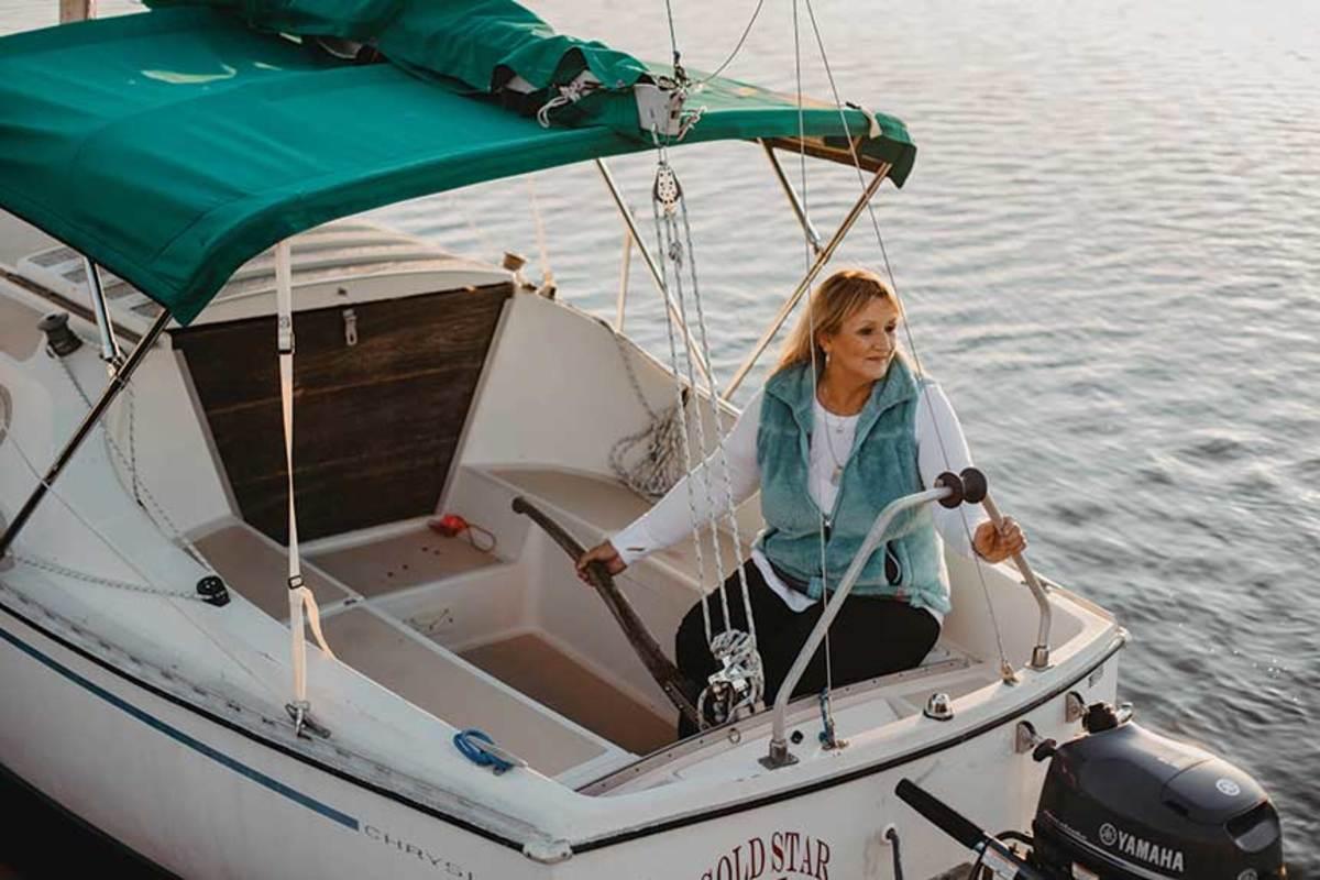 Jo Ann Boussouar on her 22-foot Chrysler near her home in Milton, Florida.