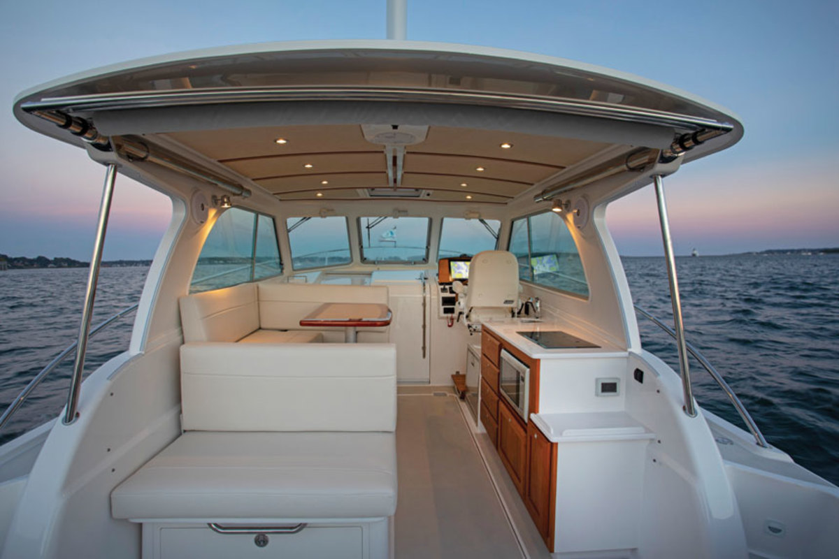 The 34O has a single-level deck,  an island berth and helm withoptional 17-inch screen.