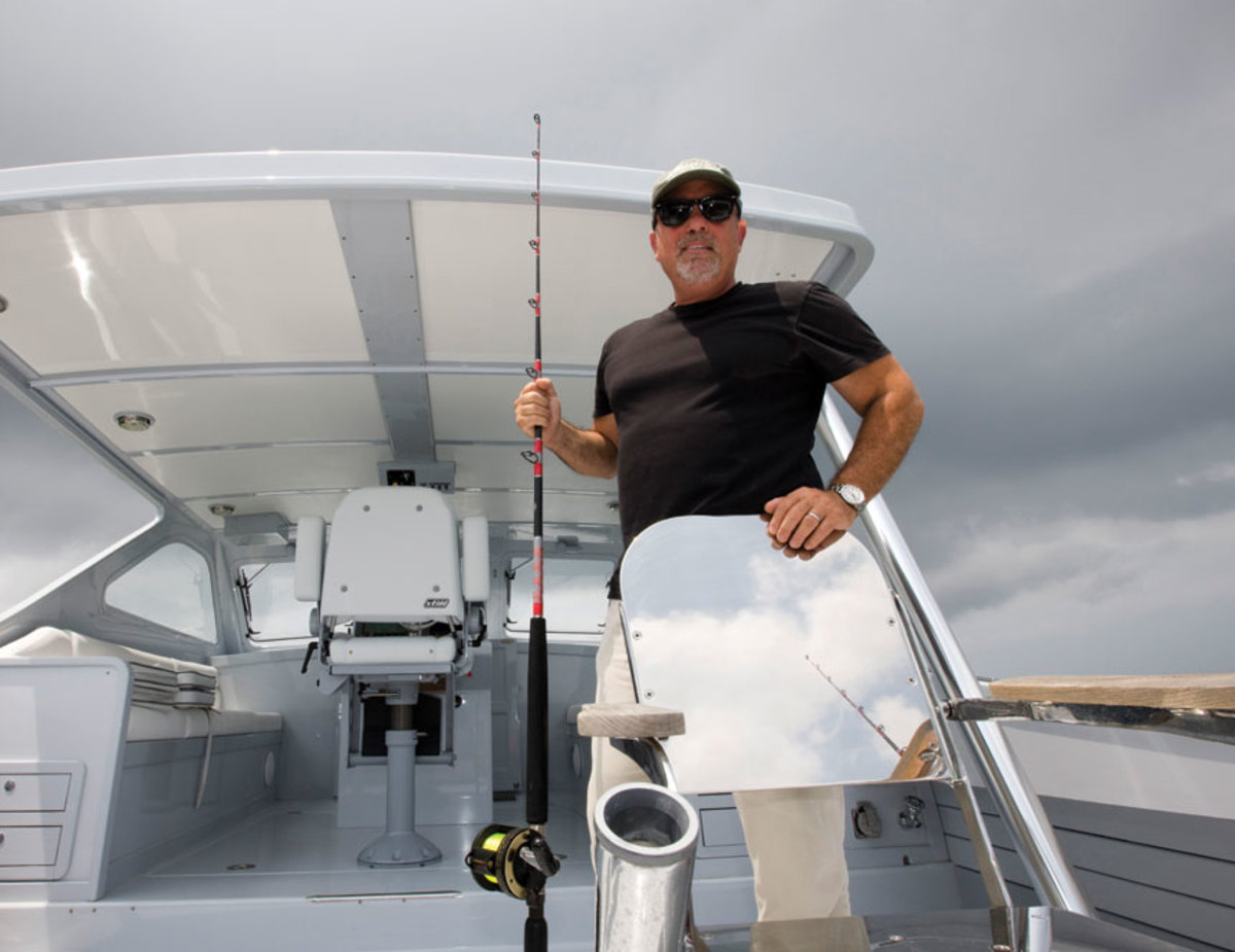 Joel aboard the Ellis 36 Argos in 2008. The boat had a  streamlined superstructure reminiscent of sportfishing vessels of an earlier era and a modern Downeast hull shape.