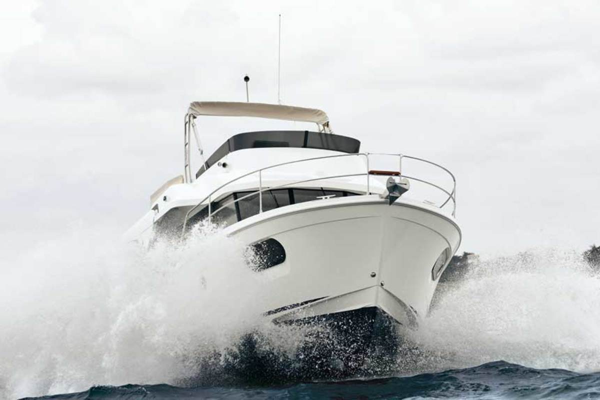 "LOA : 37'0"" / Beam: 13'0"" / Draft: 3'10"" / Displ.: 18,187 lbs. / Fuel: 211 gals. / Water: 80 gals. / Power: (1) 425-hp Cumminsw diesel / Price: $505,000"