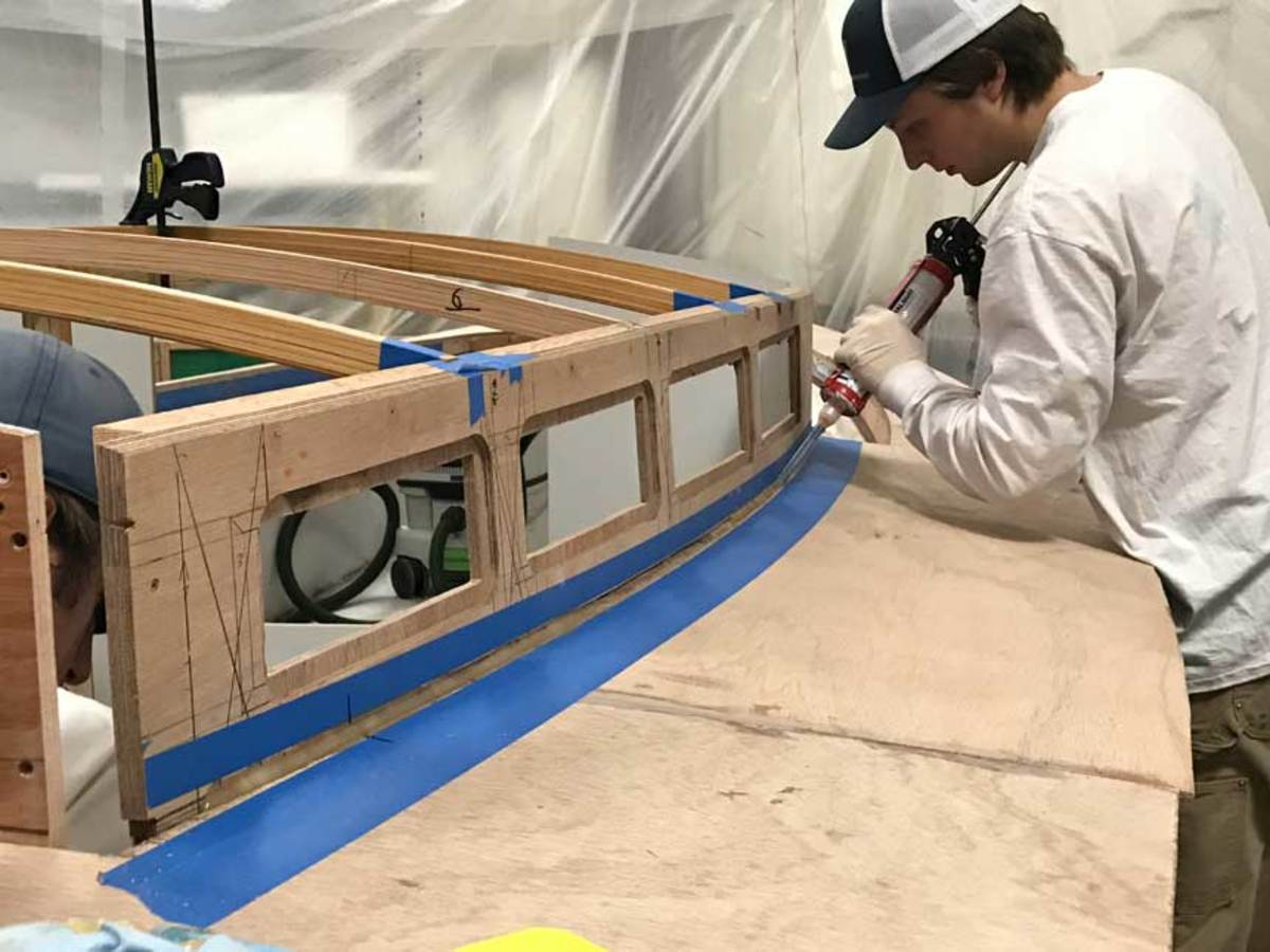 TotalBoat Thixo Flex is applied to the house sides to bond mahogany sides and deck.
