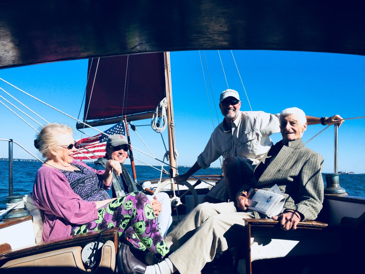 Rob Atkinson (at the helm) takes a World War II vet for a spin aboard Caithness