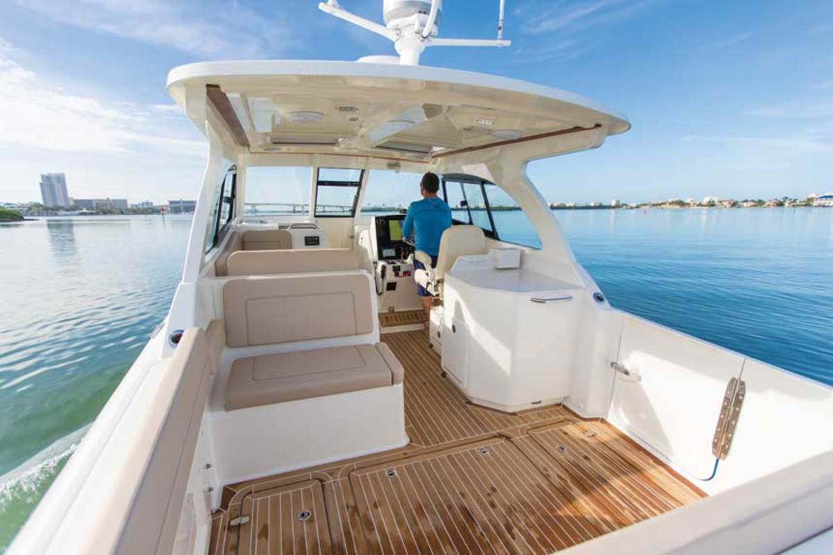 """LOA : 32'6"""" / Beam: 10'8"""" / Draft (engines up): 1'9"""" / Dry weight: 11,500 lbs. / Fuel: 250 gals. / Water: 30 gals. / Power: (2) 425-hp Yamahas / Price: $359,000"""
