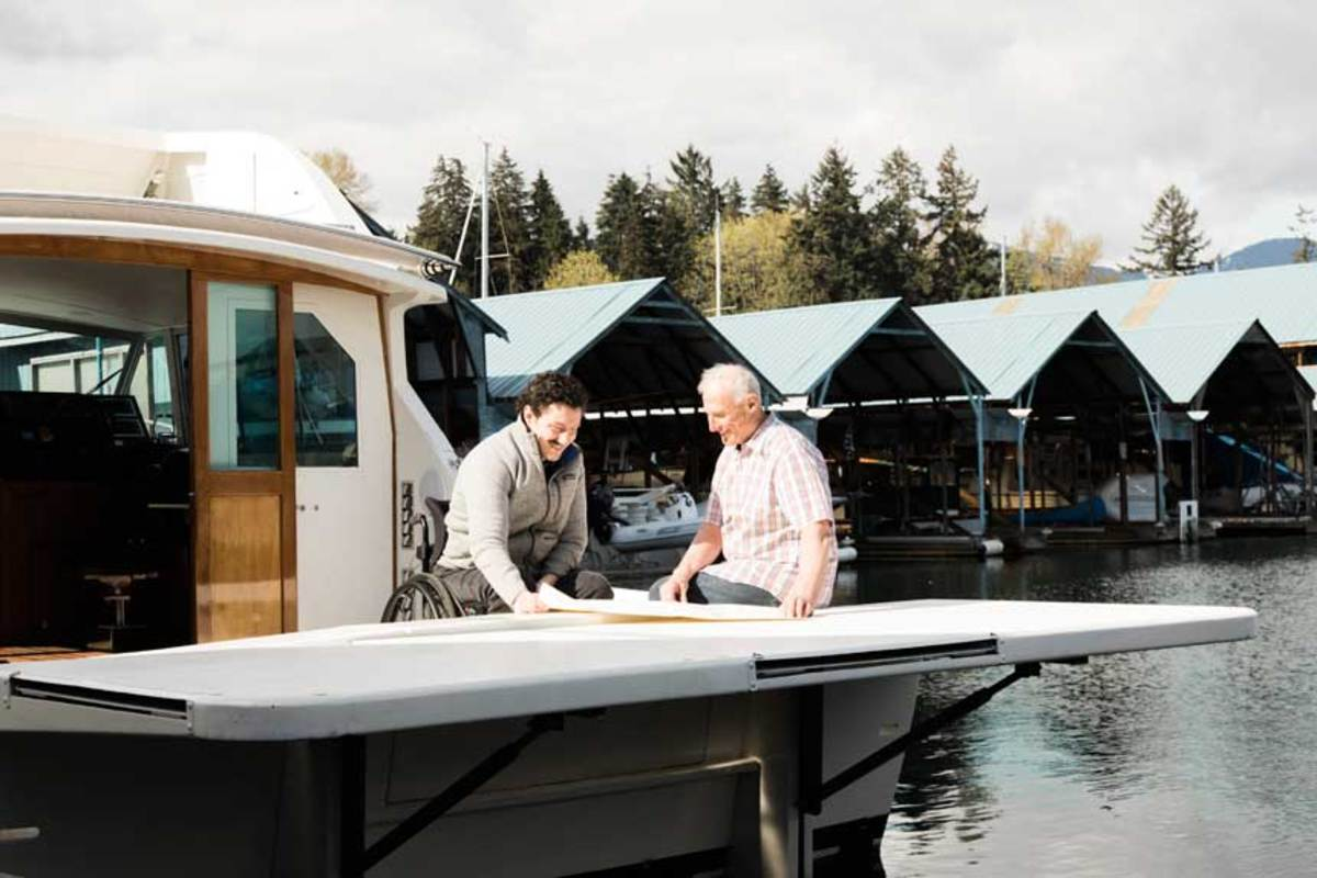 Blake and his father, Bob, rebuilt the old Bertram with accessible features like an aluminum swim platform.