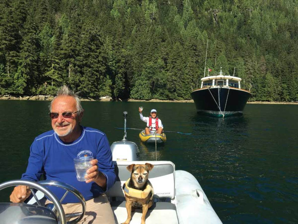 Dan and Lola tow a friend in British Columbia; dining aboard in Ghent, Belgium.