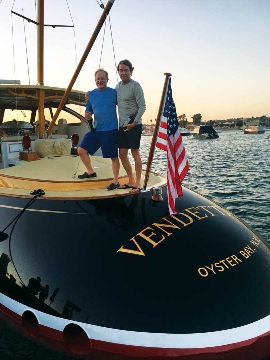 Rudy Svrcek and MIke Sullivan on the original boat with barrel-back raised deck.