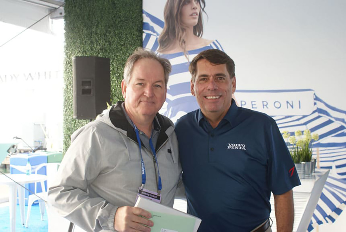 Soundings Executive Editor Pim Van Hemmen accepts his first-place award from Volvo Penta's Ron Huibers. Volvo Penta sponsored the Boat Tests & Reviews category for the Boating Writers International annual writing contest.