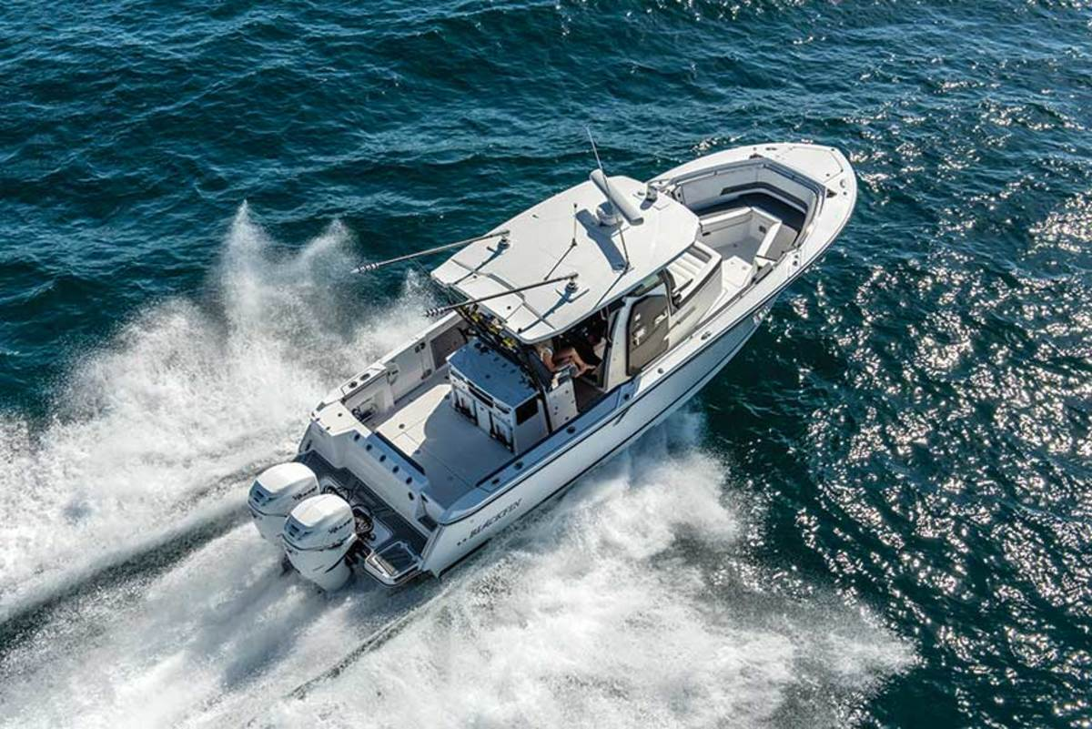 "LOA: 33'2"" / Beam: 10'6"" / Weight: 10,500 lbs. / Power: (2) 300-hp Mercury Verado 4-strokes / Price: $318,114"