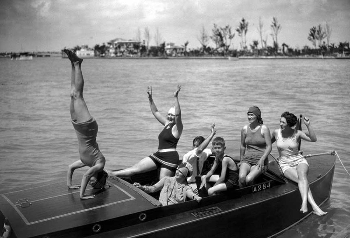 Shot in Miami in the 1920s, women ham it up on a Baby Gar.