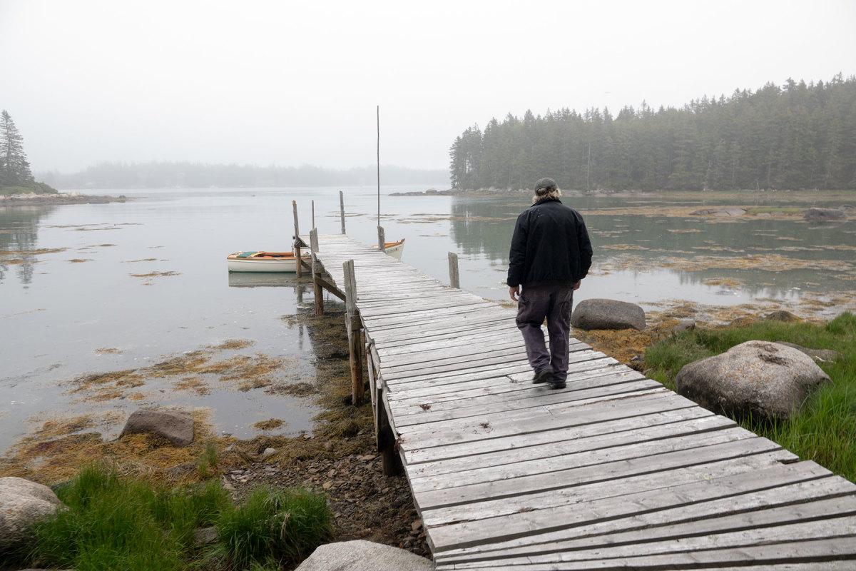 Mark Jackson walks down his dock on Greens Island