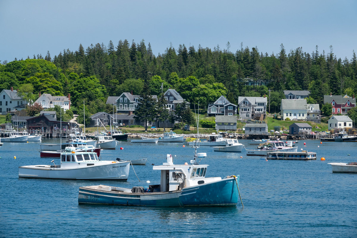 Working boats dominate the scene in Carvers Harbor.