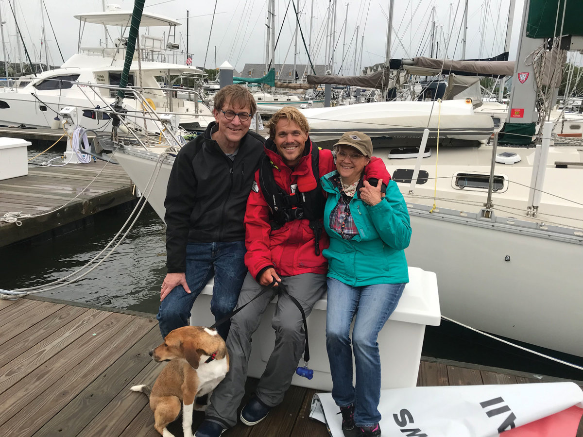 Will Viss is greeted by his parents at his homeport on the Chesapeake Bay after he singlehanded his Beneteau 381 from St. John and through a tropical storm.
