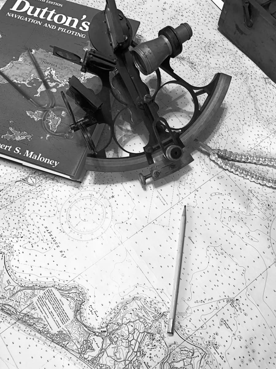 Chart, sextant, and pencil: simple tools of the trade used by mariners for centuries for a complex task