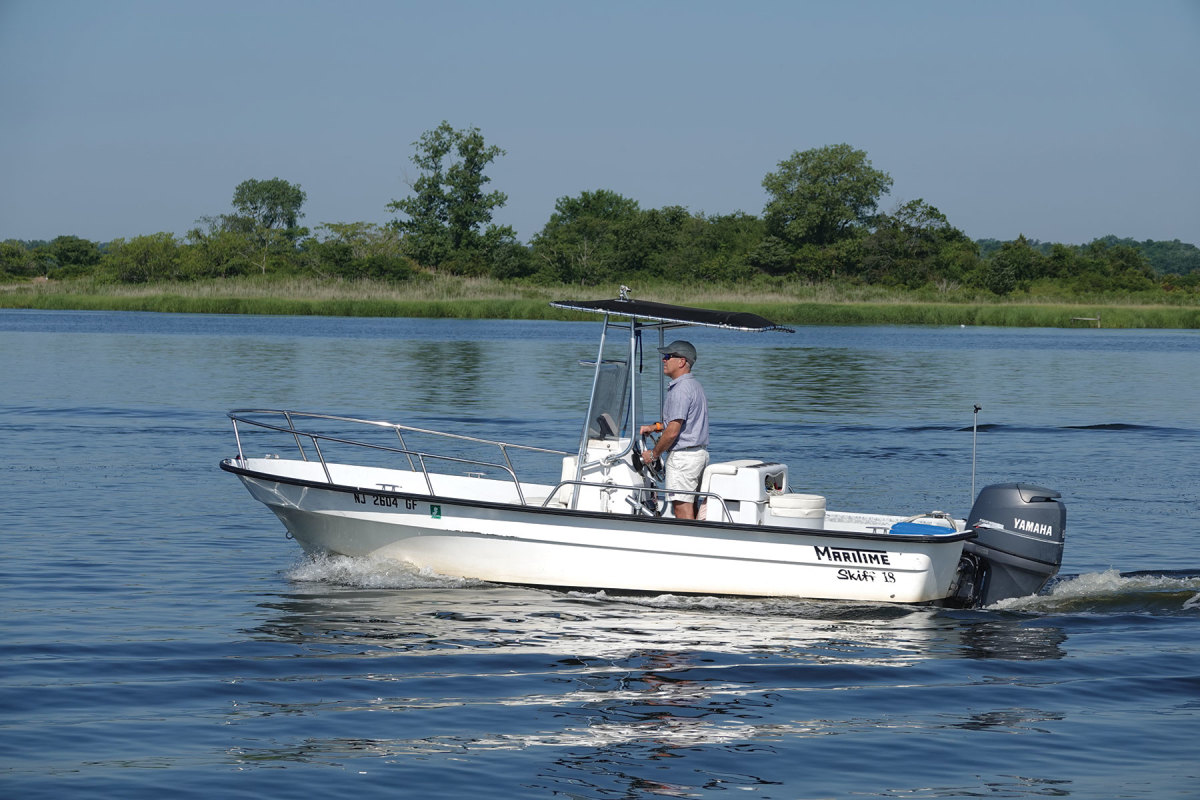 "LOA: 18'9"" , Beam: 7'6"" , Draft: 9'0"",  Weight: 1,500 lbs. , Power: (1) 60- outboard,  Fuel: 10 gals."