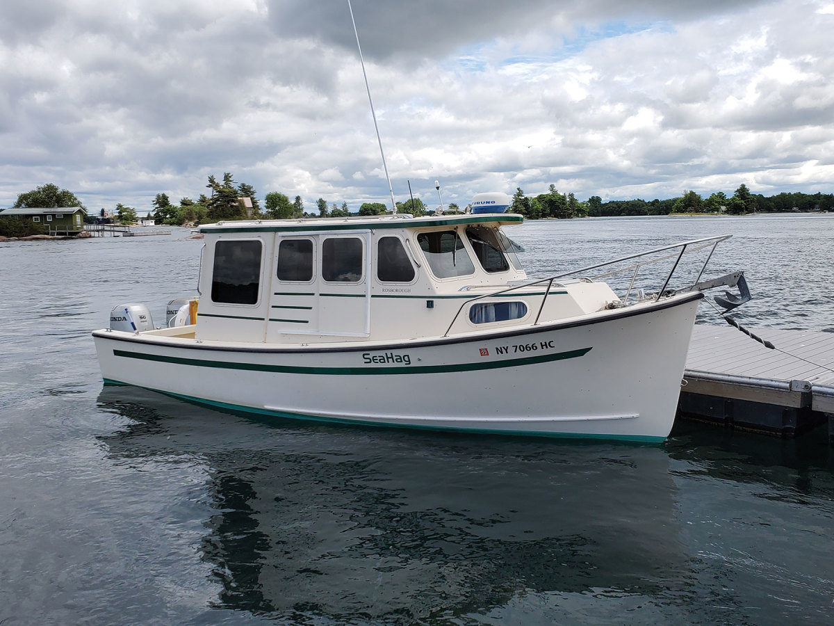 """LOA: 25'0"""",  Beam: 8'6""""   ,Draft: 2'0"""", Weight: 5,400 lbs.,  Power: (2) 90-hp outboards,  Fuel: 115 gals."""