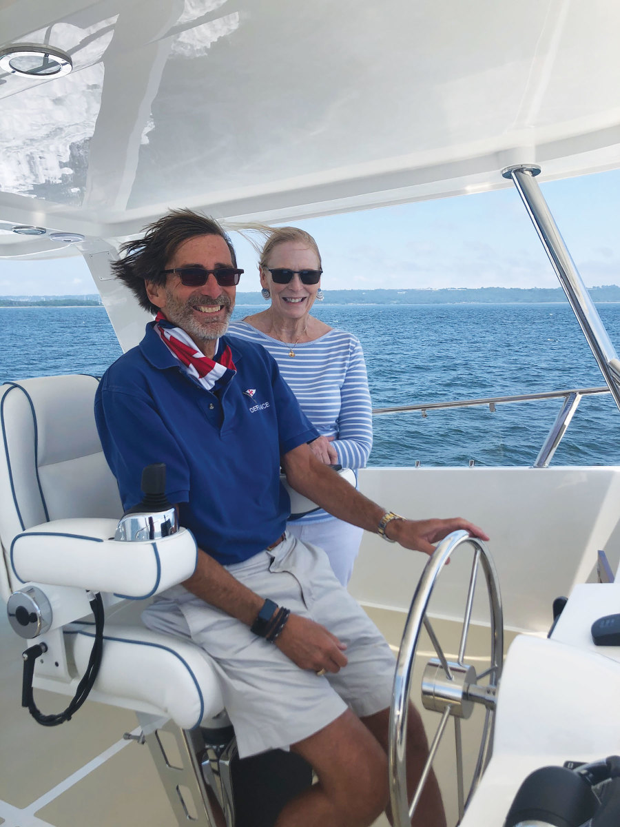 Jim and Cindy Cuminale at the flybridge helm of their new Hunt 63