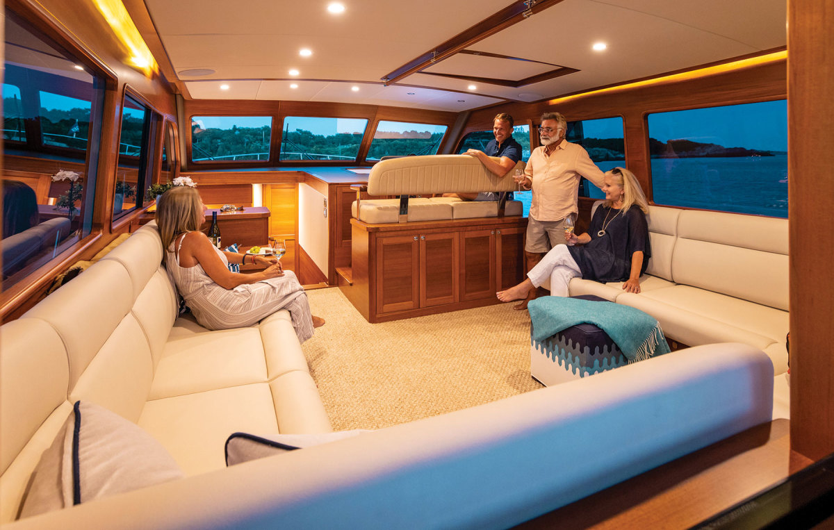 The standard layout features an open salon with stairs leading down to the galley, but a galley-up version is offered, too.