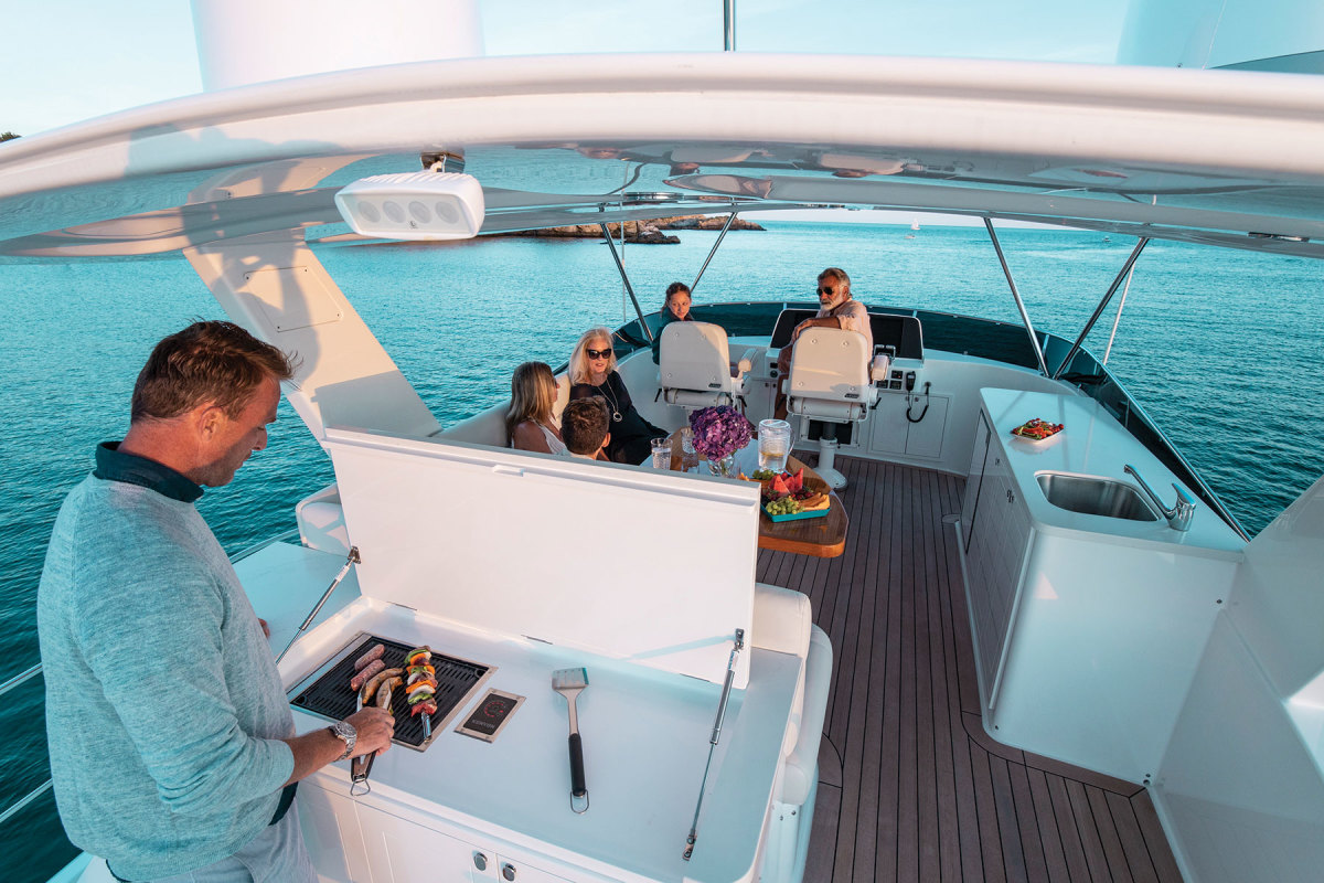 The flybridge with hardtop is designed for entertaining with dining table, wet bar and grill.