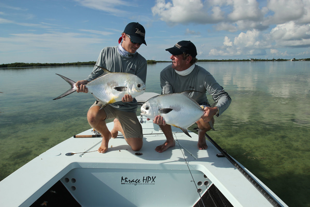 Scott Deal (right) and his son, Clay, on a Maverick flats boat