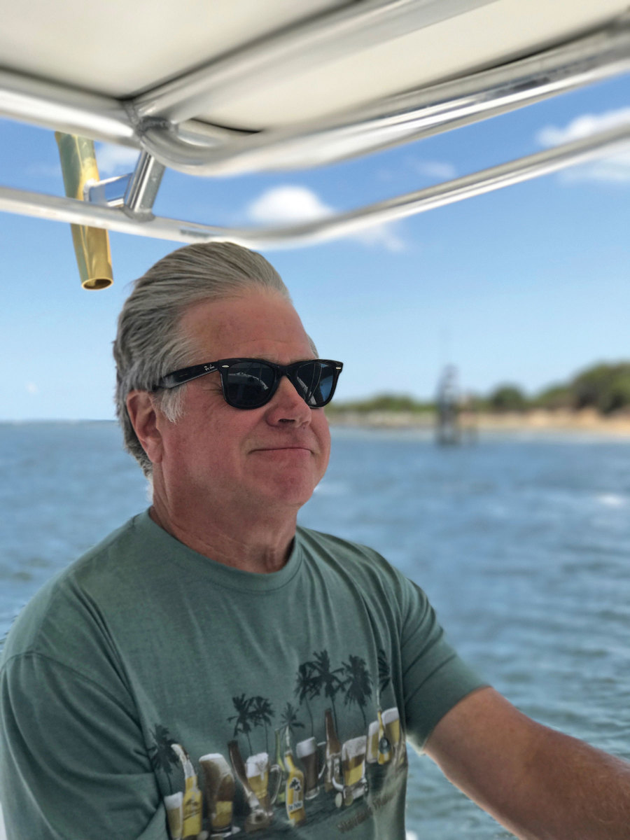 Bruce Dowd enjoys the dry ride and generous cruising range offered by his Tarpon Stamas 310, one of three boats in his fleet.
