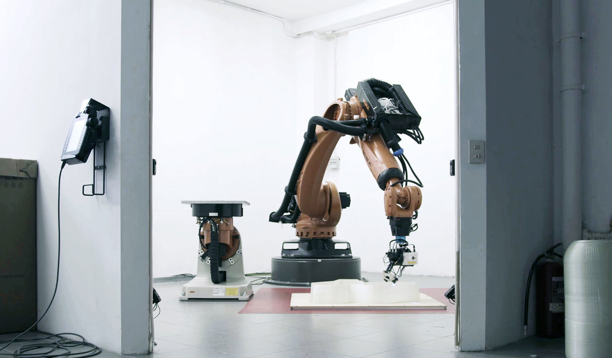 Mambo was created by robots that produced multiple sections, which were assembled and laminated. Humans added the deck, seats and paint.