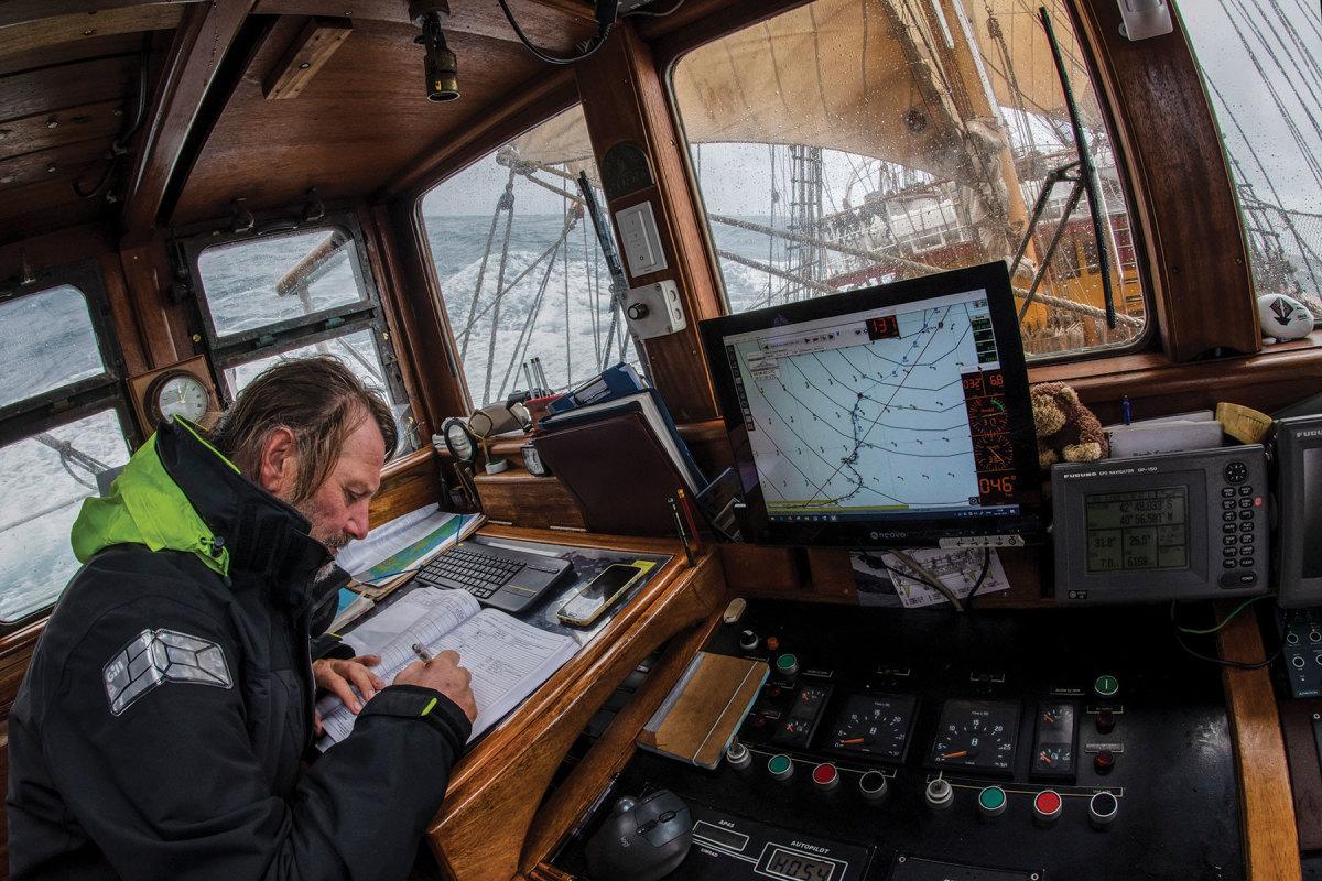 Capt. Eric Kesteloo keeps the ship's log as Europa sails across the Atlantic.
