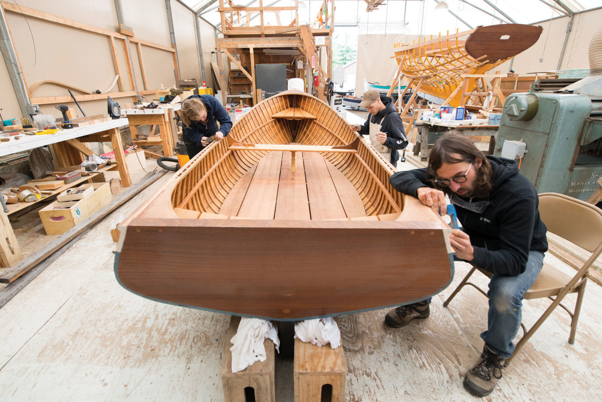 Students work on a variety of watercraft during their time at the school.