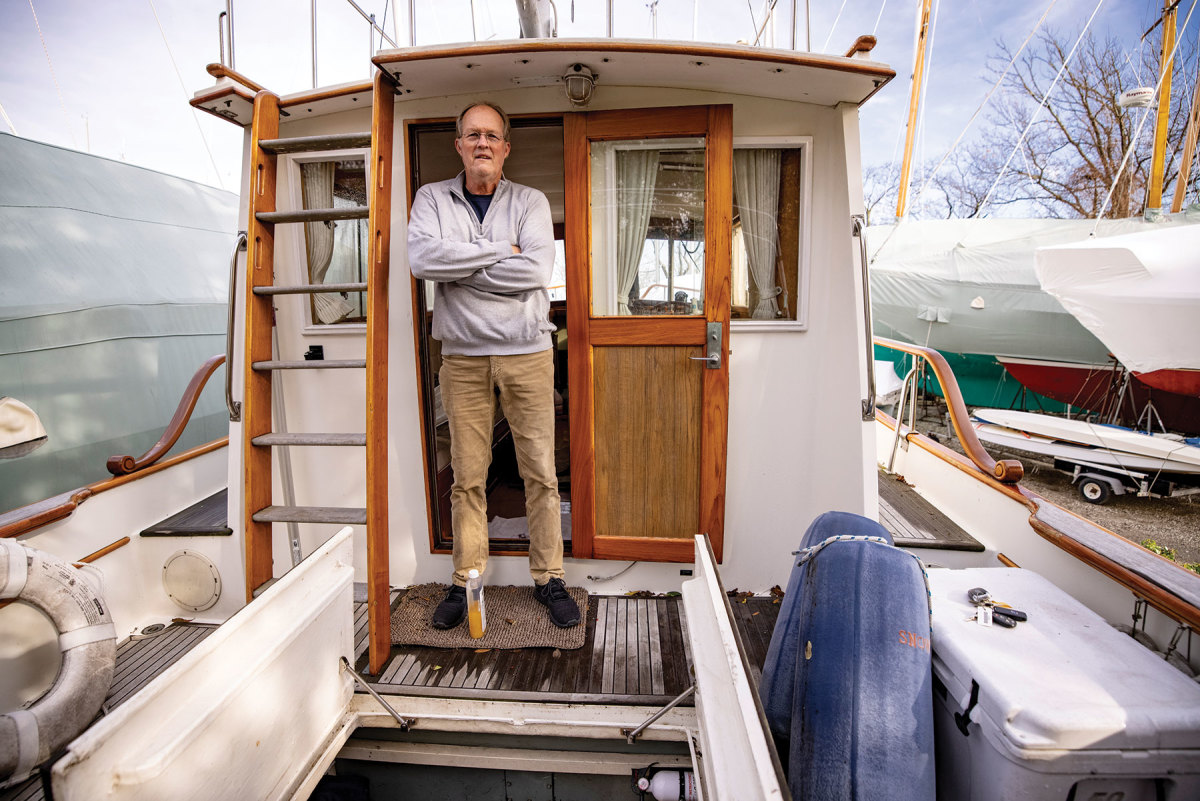 Nautical photographer Onne van der Wal aboard Snow Goose, the 1986 Grand Banks 32 he and his wife recently purchased. Van der Wal is a trained machinist and will do the renovation himself.