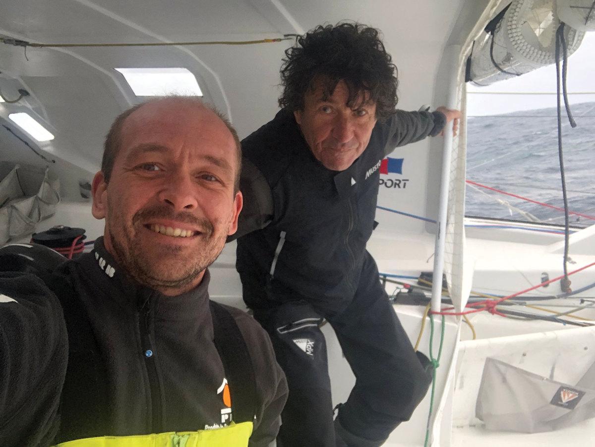 After the rescue, Escoffier (left) shoots a selfie with Le Cam.