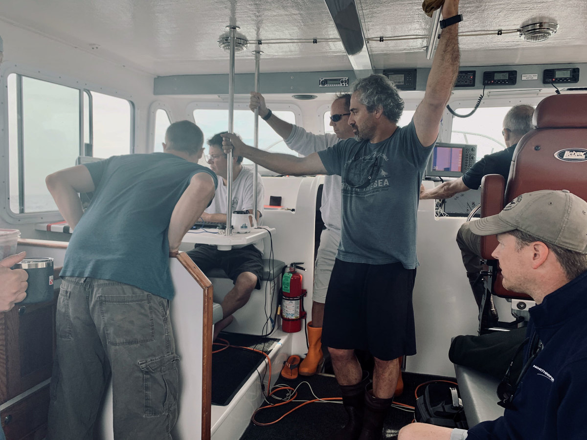 The crew, with Mazraani in center, waits for sonar to pick up signs of the wreckage