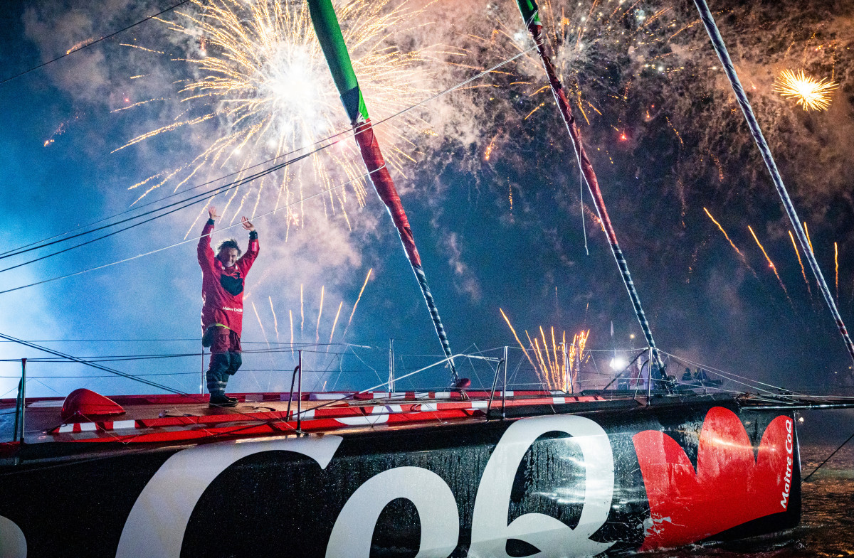 Yannick Bestaven is greeted with fireworks inLes Sables d'Olonne, France, after finishing as the overall winner.