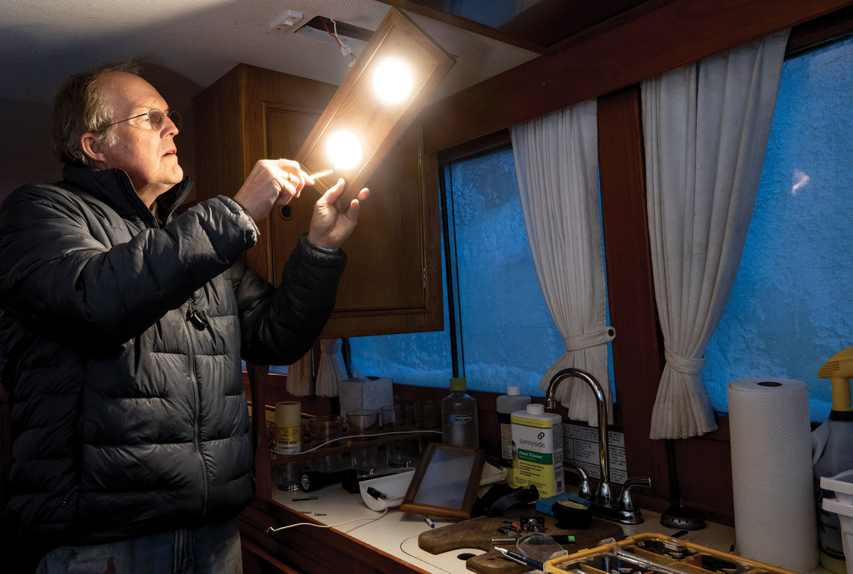 Onne installs the new lighting in the cabin