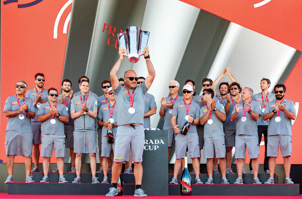 The men of the  Luna Rossa Prada Pirelli team celebrate their Prada Cup win in Auckland, New Zealand, after they defeated the British and American teams in the runup to the 36th America's Cup.