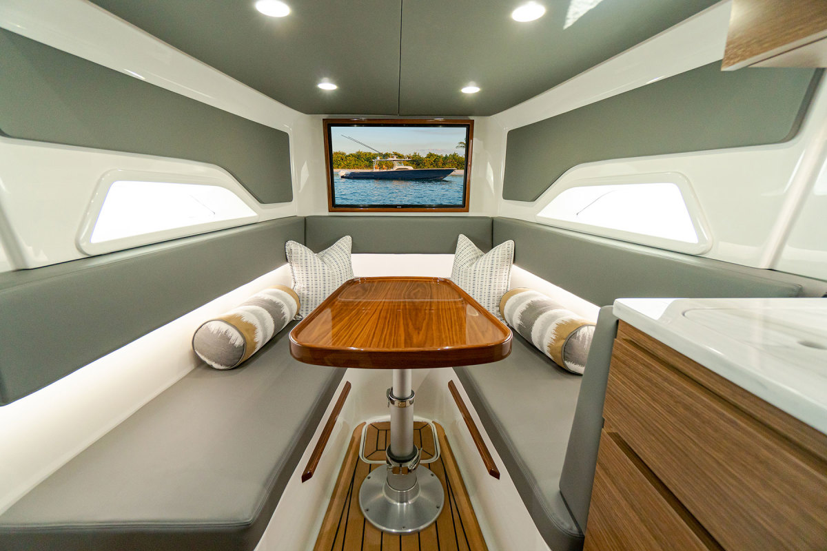 A roomy cabin features a dinette that converts to a queen berth and a compact galley.