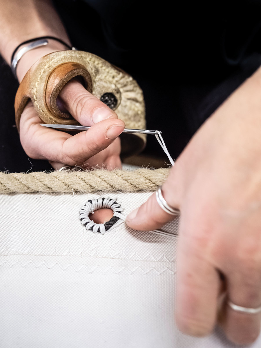 Stitching a grommet requires a steady hand.