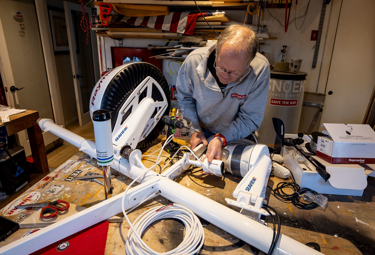 After repainting the mast and spreaders in his home workshop, Onne van der Wal works out the placement of his new navigational instruments before he starts drilling.