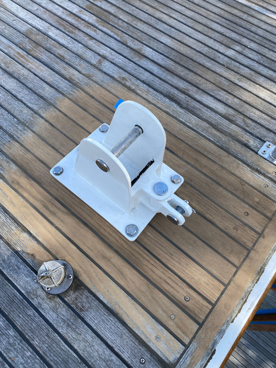 Because the teak around the mast had worn down, Onne sanded the spot for the tabernacle so it wouldn't sit proud of the deck.