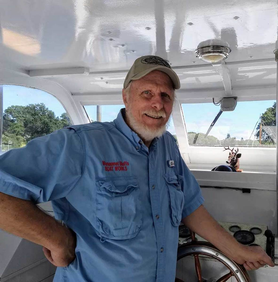 David Arch enjoys working on his classic boat, which can handle varying sea conditions with ease.
