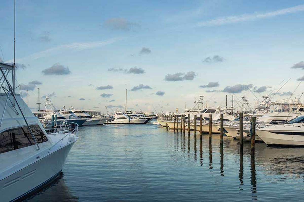 Your boat may seem fine in its Florida slip, but your insurance policy could require it to be farther north in hurricane season. The trouble is, there may not be dockage available as marinas are full.