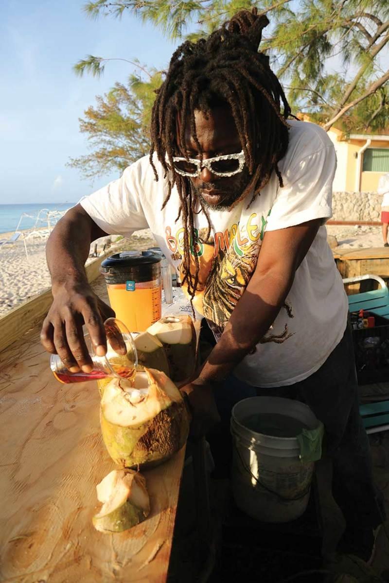Coconut Brian serves rum drinks at his beachside bar