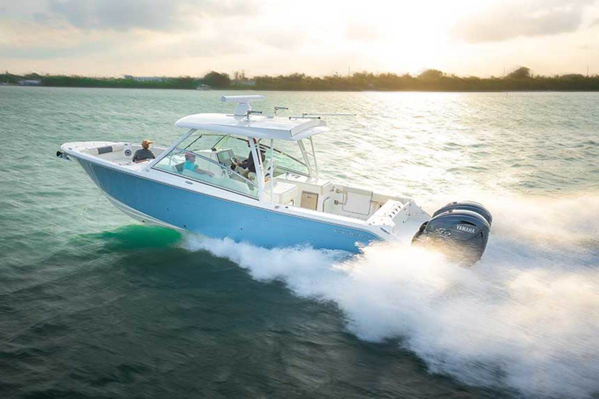 """LOA: 33'6"""",  Beam: 10'9"""" , Weight (w/power): 9,981 lbs.,  Fuel: 275 gals.,  Water: 30 gals. , Power: (2) 300-hp Yamaha F300 4-strokes , Base Price: $261,050"""