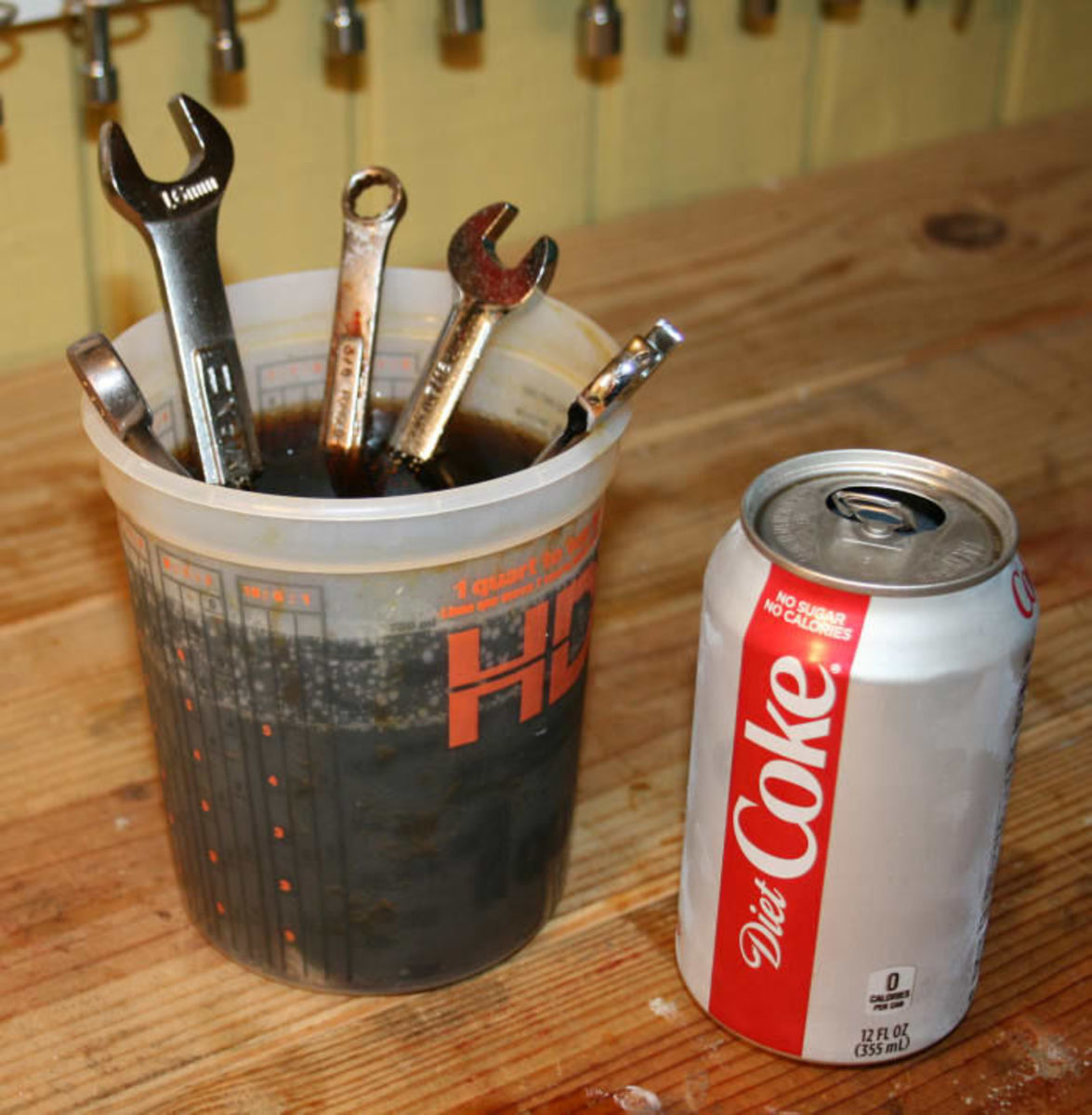 Container short-statured? End-for-end your wrenches and keep on soaking.