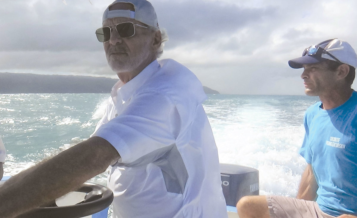 The author (at left) throttling toward the somewhat secret harbor on the north coast of the Dominican Republic
