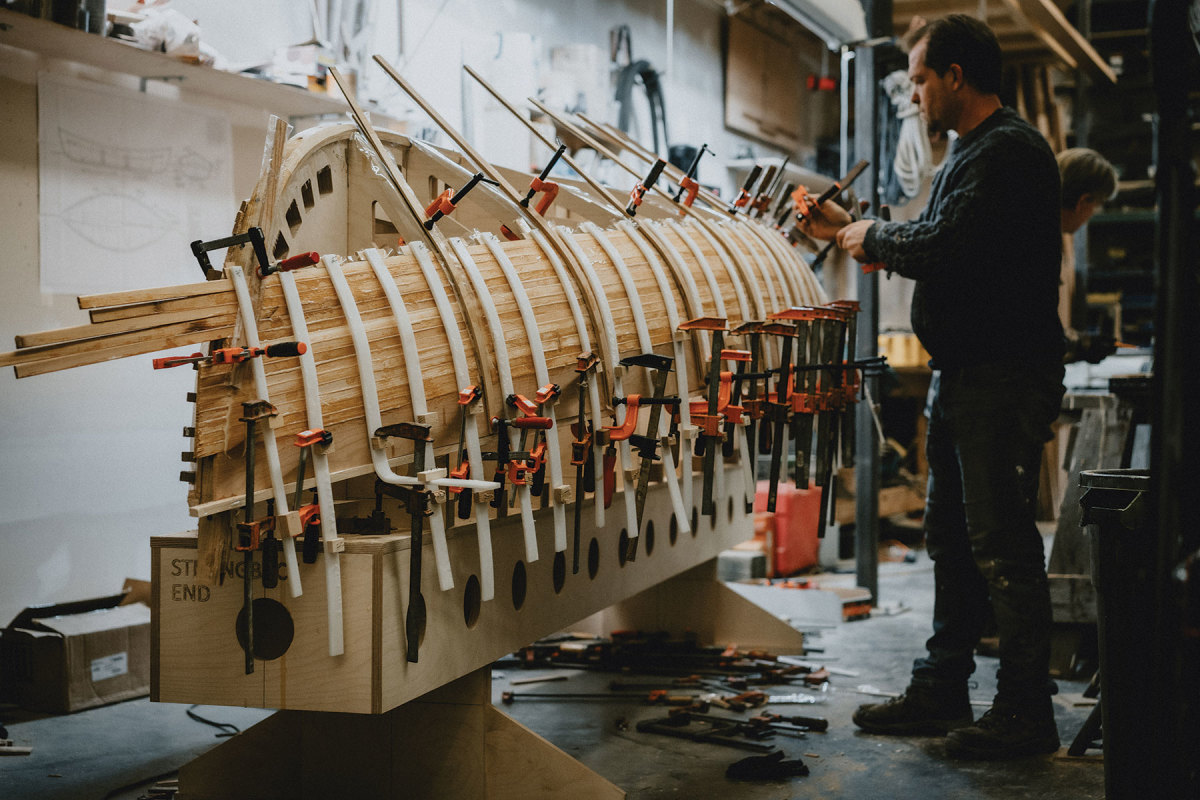 Using cold-molded construction, Sparkman & Stephens simply glues and clamps strip planking to the frames, eliminating the need for rivets and drastically reducing the boat's weight.