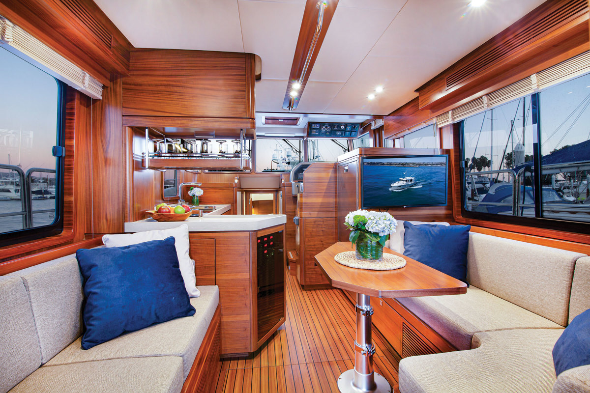 The salon is aft of a shippy-looking helm