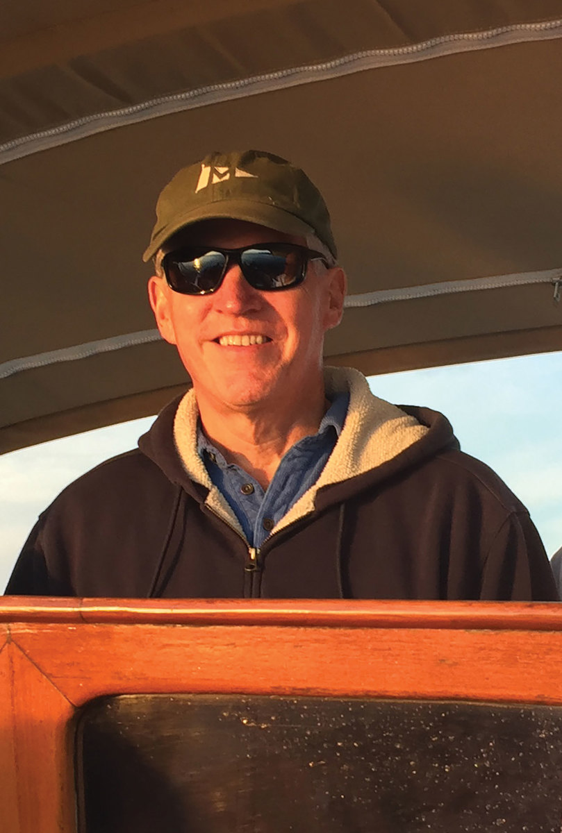 Bill Tracy at the helm of his Roth Bilt 21, which he uses for day trips, sunset cruises and gatherings with friends.